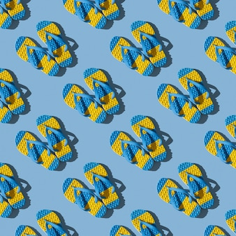Seamless pattern of yellow and blue flip flops