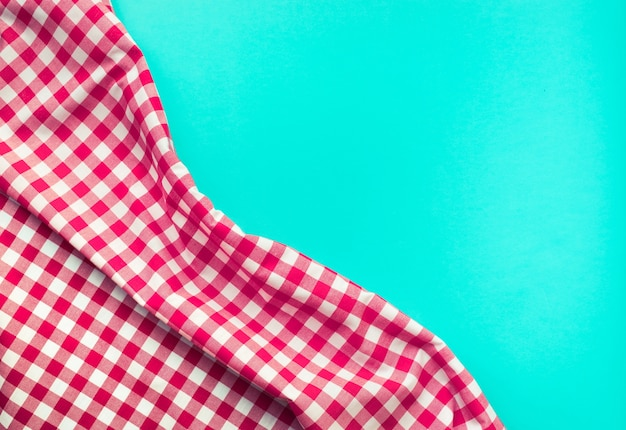 Seamless red checkered fabric with blue background