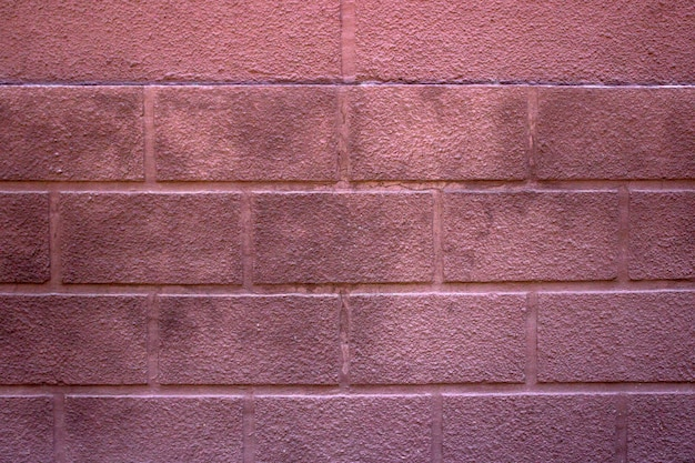 Seamless red painted brick wall texture. pale colors