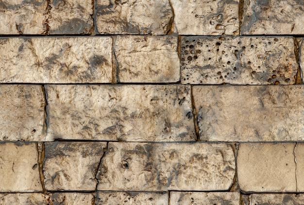 シームレスなテクスチャレンガの壁の背景。
