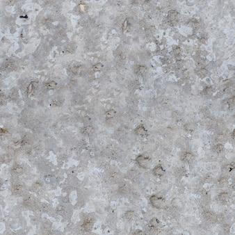 亀裂の背景を持つシームレスなテクスチャコンクリート砂レンガ古い灰色の石の壁。