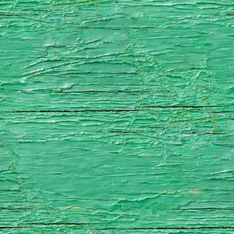 緑の塗られた木の板のシームレスなテクスチャ
