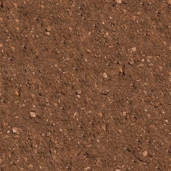 Бесшовные бесшовное текстуры коричневой вспаханной почвы
