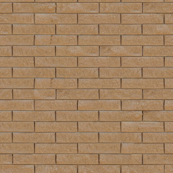 装飾的なレンガの壁のシームレスなタイル張りのテクスチャ