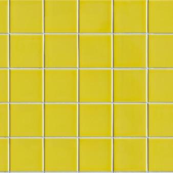 黄色いタイルのシームレスなタイル張りのテクスチャ