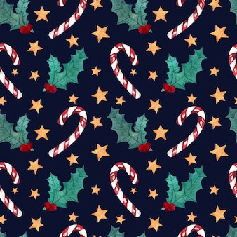 Seamless watercolor pattern with christmas sweets, mistletoe sprig and stars on a dark background