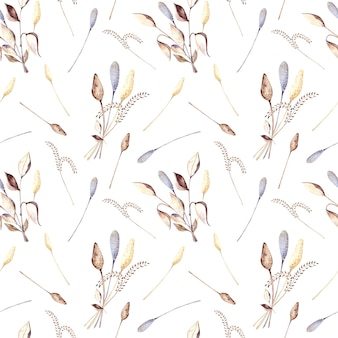 Seamless watercolor pattern with colored twigs of dried flowers and beige and dry leaves on a white background