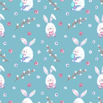 イースターのウサギ、柳の小枝、色付きの背景の花とのシームレスな水彩パターン。