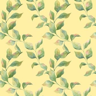黄色の背景、リンゴの枝に緑の春の葉とシームレスな水彩パターン