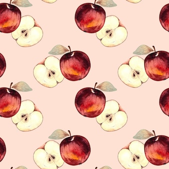 Seamless watercolor pattern with red apples and apple slices on a pink background.
