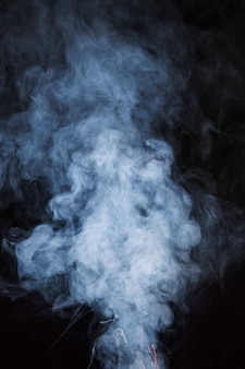 Seamless white smoke texture black background
