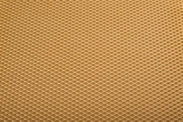 シームレスな黄色のハニカムテクスチャ。幾何学的な抽象的な背景。テンプレート。