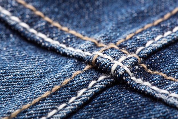 Швы на синих джинсах