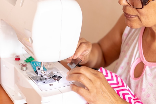 Seamstress woman working with her sewing machine
