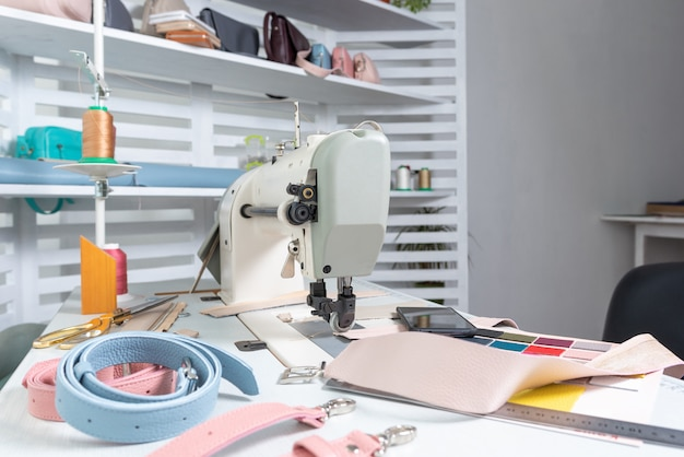 Seamstress workplace and many items on the table