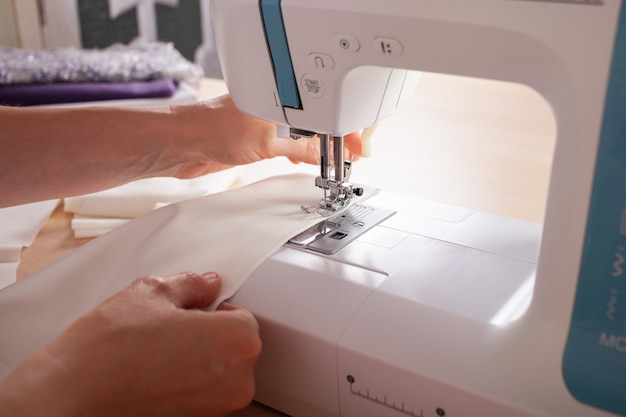 The seamstresses are stale on the sewing machine