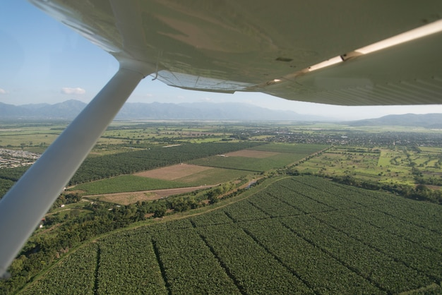 Seaplane flying over agricultural fields, bay islands, honduras