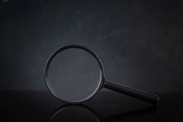Search concept. magnifying glass on dark background