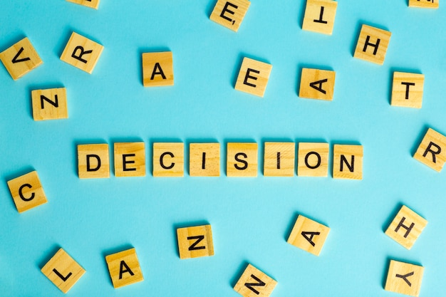 Search for decision concept. the word decision composed of heaps of different letters on a blue background