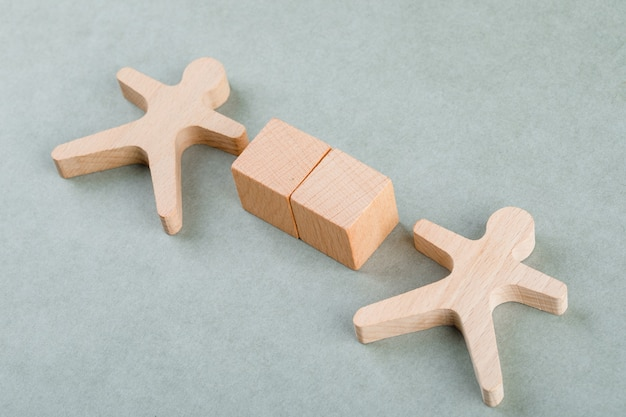 Search employee concept with wooden blocks with, wooden human figure.