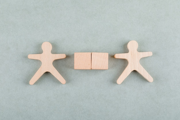 Search employee concept with wooden blocks, wooden human figure top view.