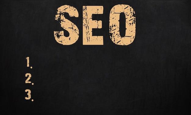 Search engine optimization concept written on blackboard.