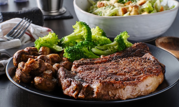 Seared ribeye steak with broccoli and sauteed mushrooms