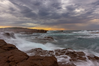 Seascape Anna Bay beach in  morning with sunrise sky and dramatic strom cloud