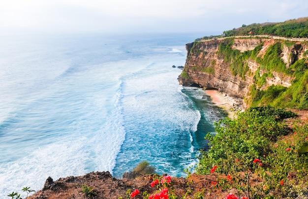 Seascape, ocean at sunset. ocean coast with waves near uluwatu temple at sunset, bali, indonesia.