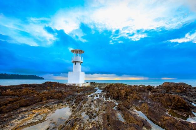 Seascape at sunset, lighthouse on the coast