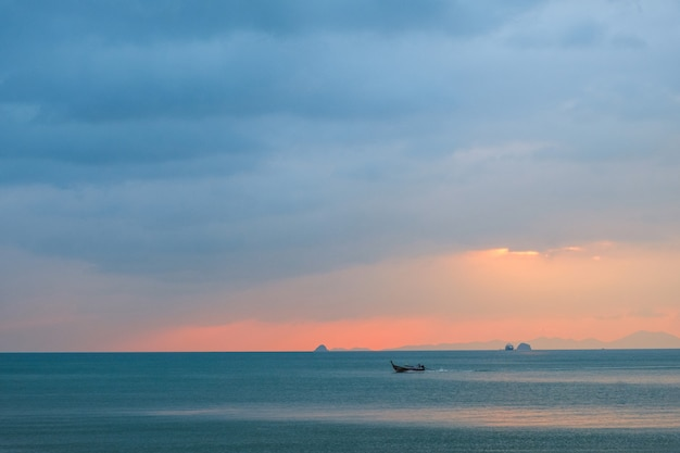 Seascape at sunset with a boat in the sea