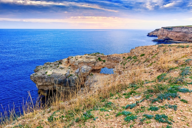Seascape with a coastline of high steep cliffs