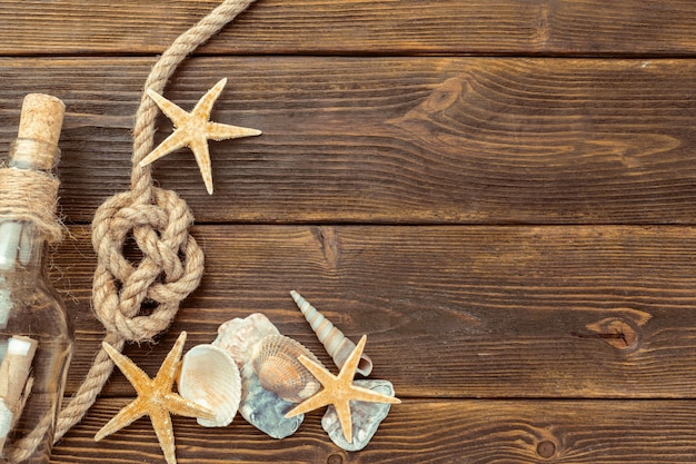 Seashells border on wood background