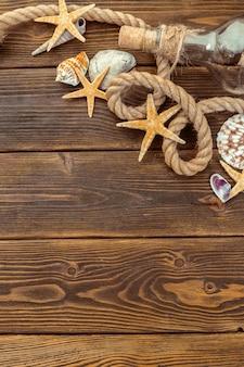 Seashells border on wood, marine