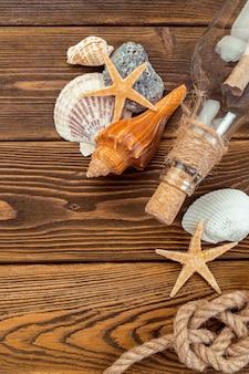 Seashells border on wood.