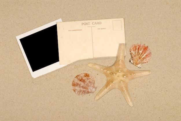 Seashore scene with polaroid starfish and postcard