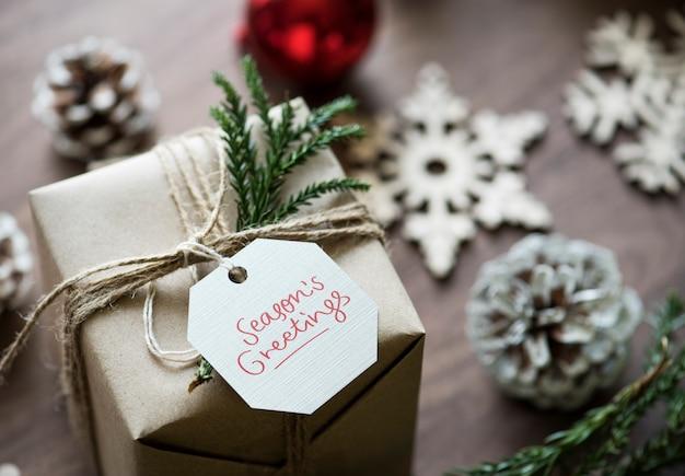 Season s greeting tag on a christmas gift box