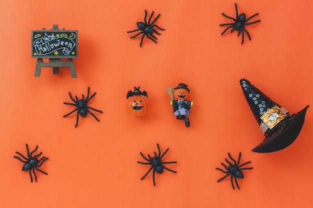 Аэрофотоснимок аксессуаров хэллоуин фестиваля фоновой концепции. различные отличительные элементы на классических оранжевых обоях на рабочем месте в офисе. выделите объект season.work space для формулировки и алфавита