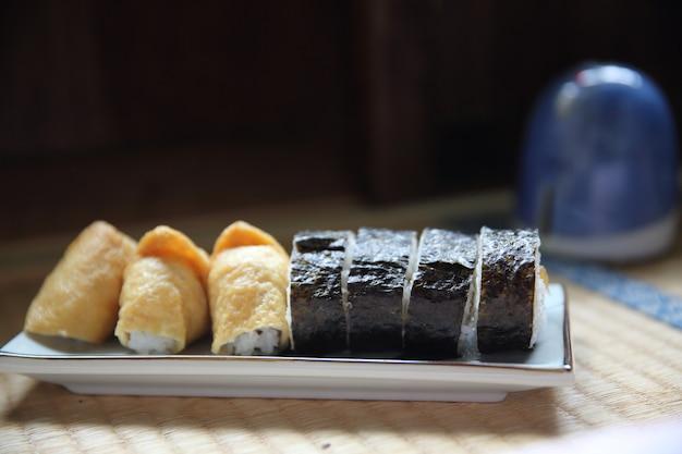 Seasoned rice wrapped in a fried tofu bag , inari sushi japanese food