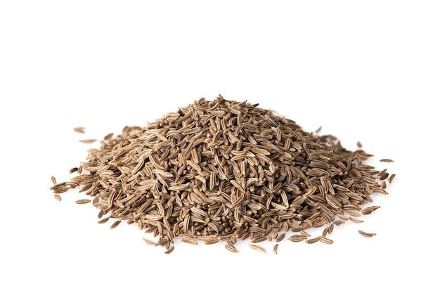 Приправы зерна тмина, изолированные на белом фоне