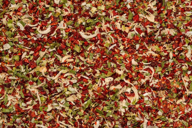 Seasoning for soup, dried vegetables slices background. top view.