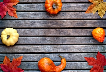 Seasons, background and texture concept- autumn colorful leaves on a wooden background.