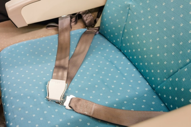 Seat belt on passenger seat in commercial airplane for safety