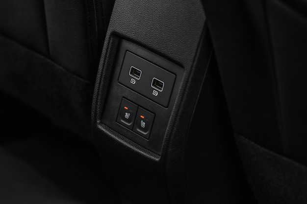 Seat heating in the car switched on. car seat heating button.