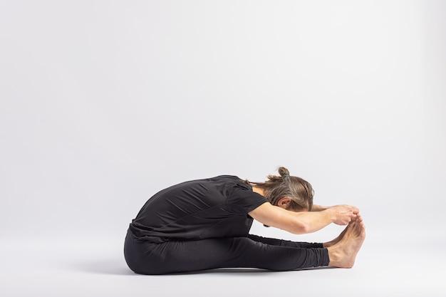 Seated pincer pose. yoga posture (asana)
