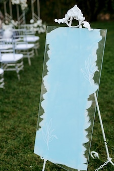 Seating card for guests at the banquet on a glass blue surface