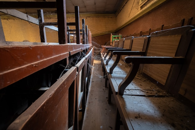 Seating of an old cinema with spiderwebs