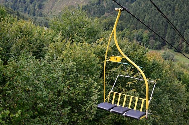 The seats of the cable car on the background of mount makovitsa, one of the carpathian mountains