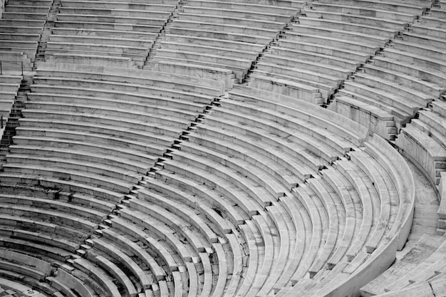 The seats of a large stadium field in black and white