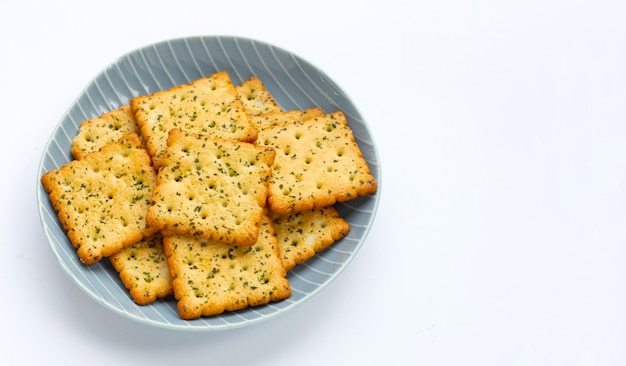 Seaweed crackers in plate on white background.